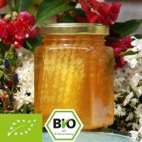 Biologische honing met hele honingraat