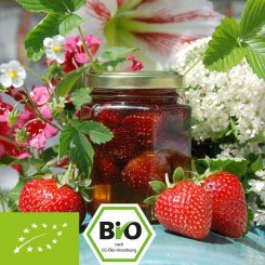 Organic acacia honey with strawberries